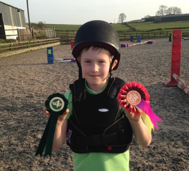 Joe With his riding rosettes