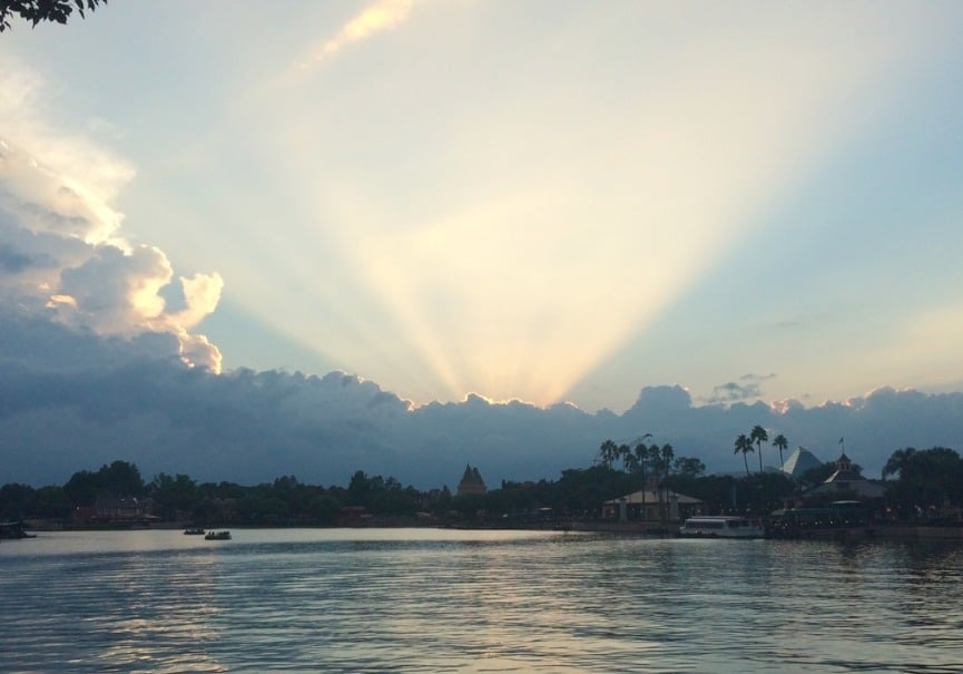 The Sun Setting behind the clouds at Epcot  www.extraordinarychaos.com