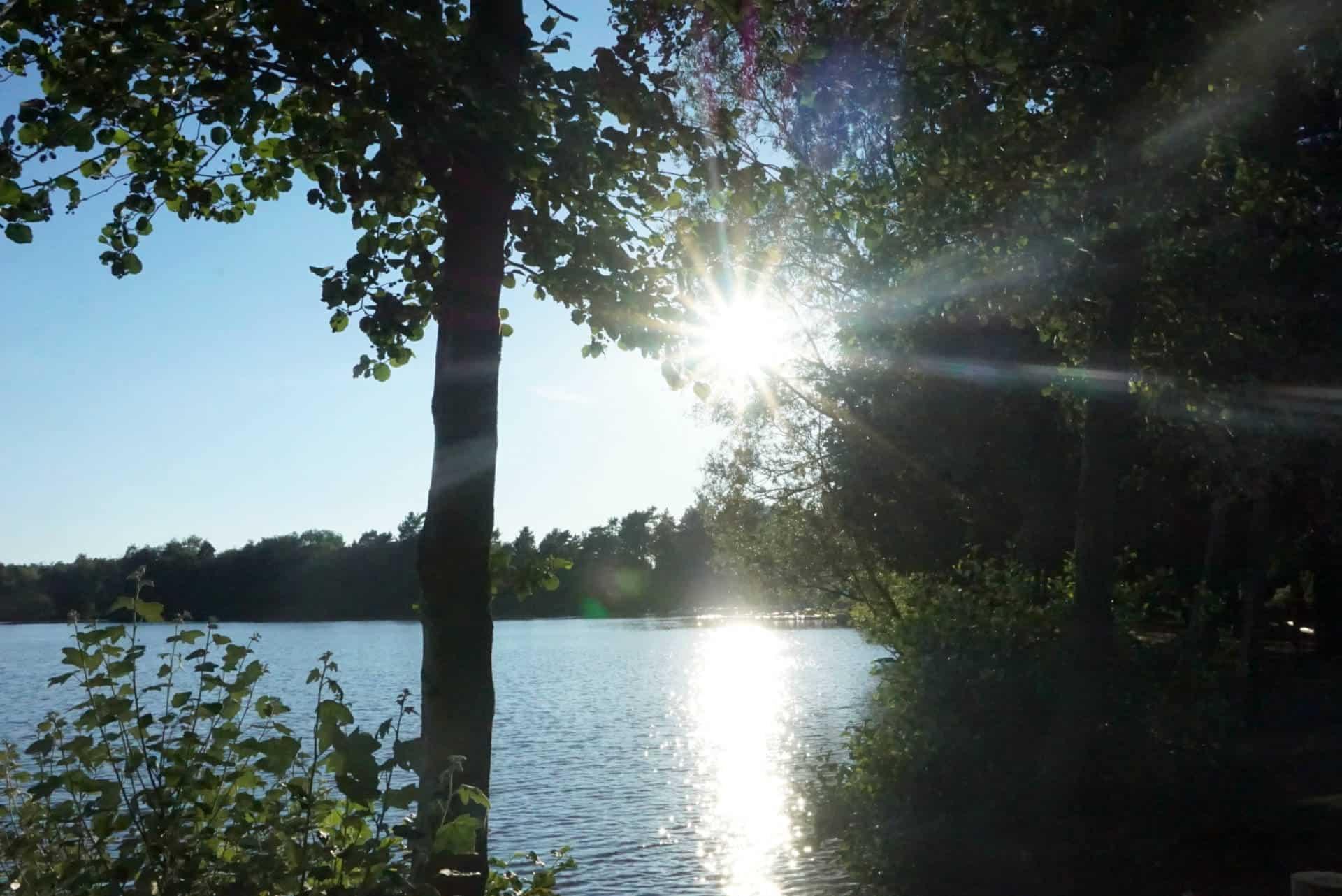 The Sun Setting On A Lake