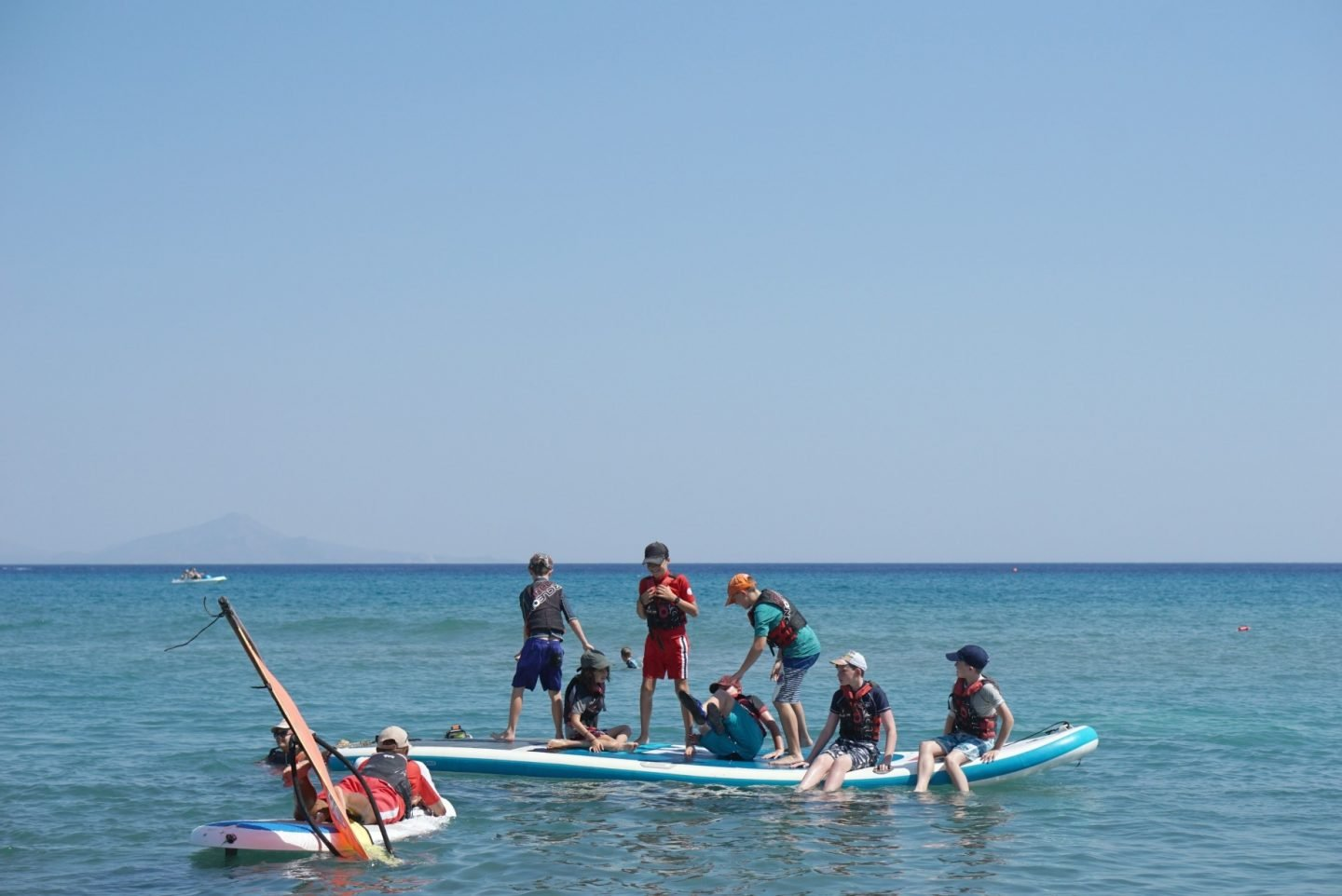 Learning to paddle board and windsurf in Greece for teens