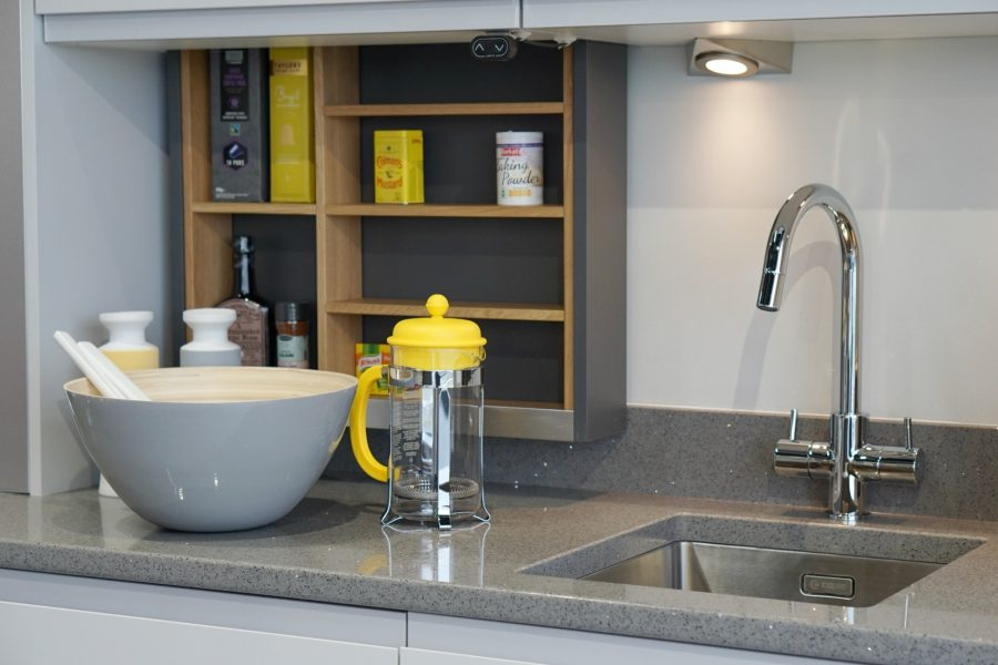 Integrated drop down kitchen cupboards at the push of a button