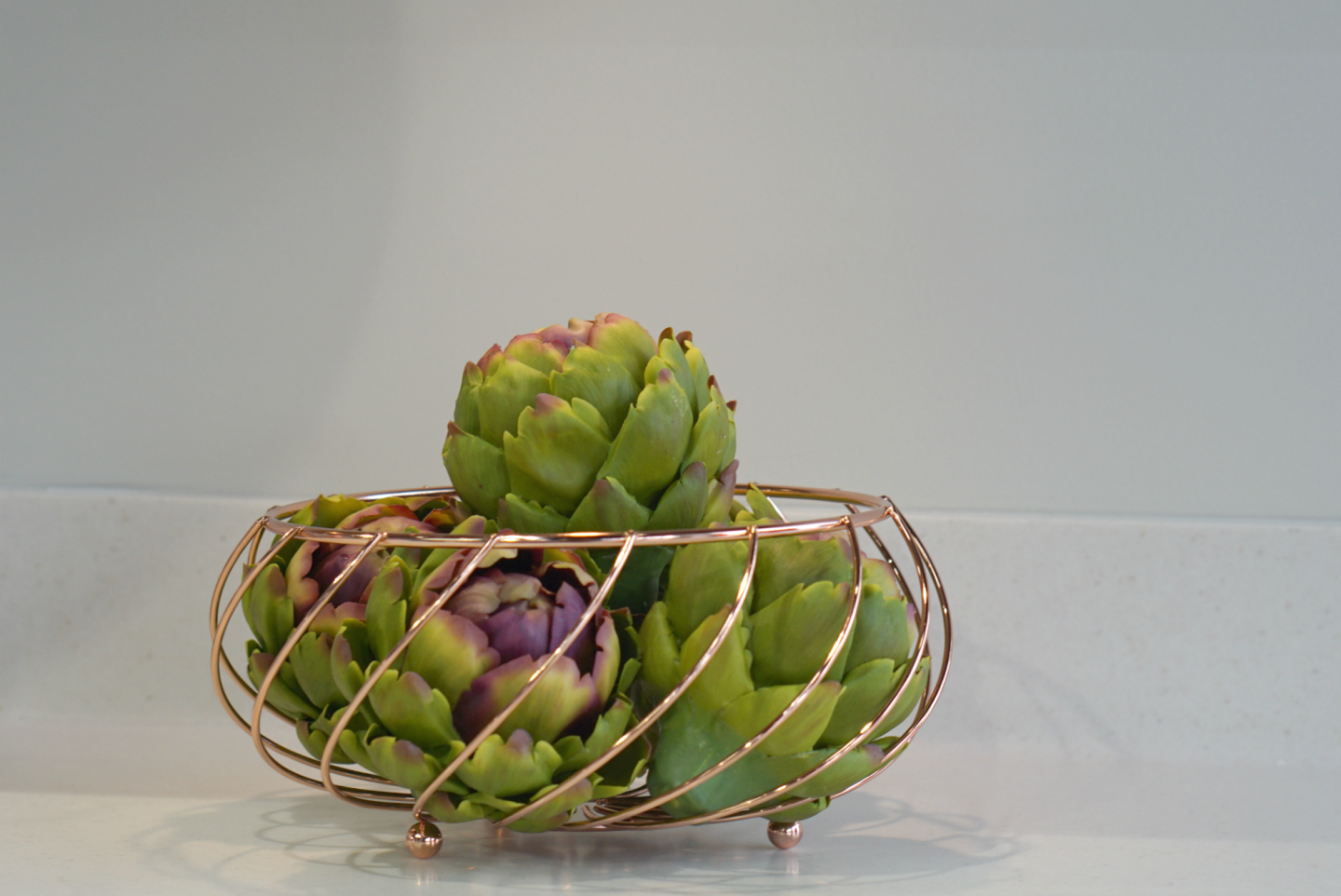 Rose Gold wire fruit basket in a Magnet Kitchen www.extraordinarychaos.com