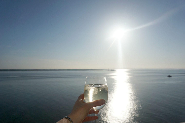 Glass of wine on balcony www.extraordinarychoas.com