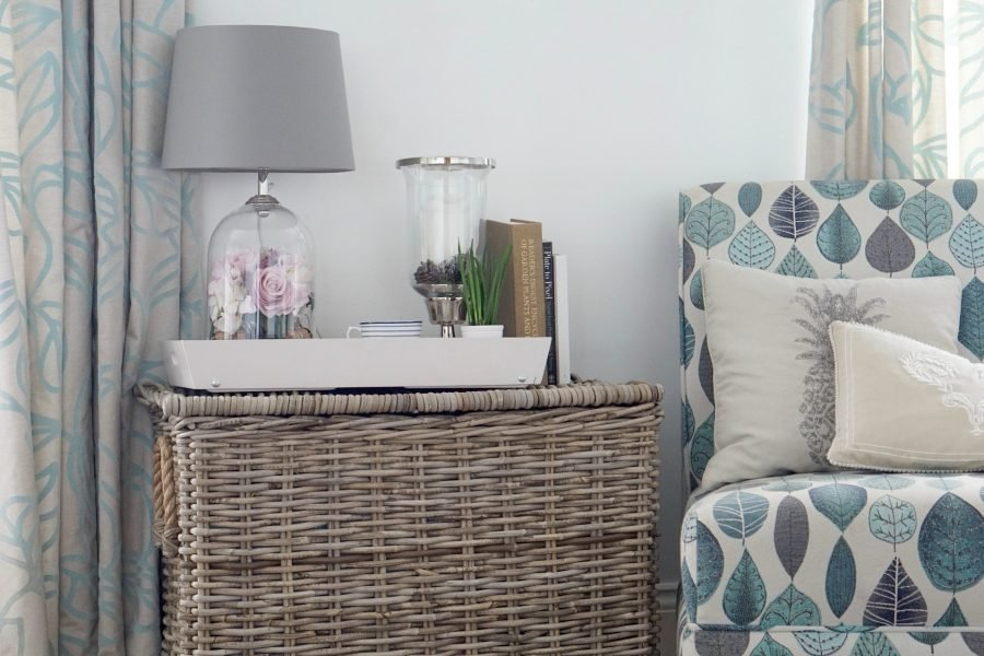Using a wicker basket as a side table
