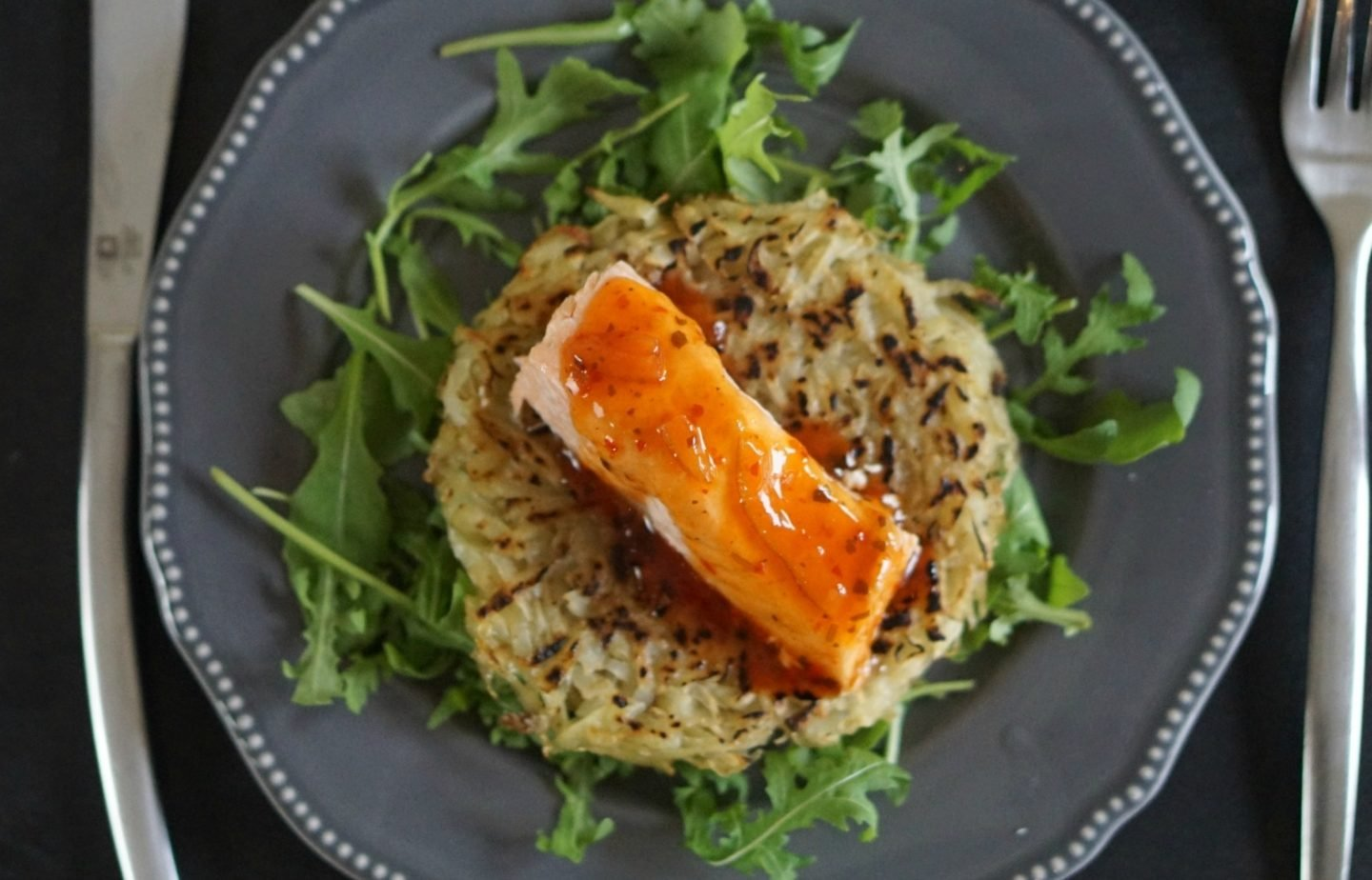 Salmon and hash brown on a bed of rocket www.extraordinarychaos.com