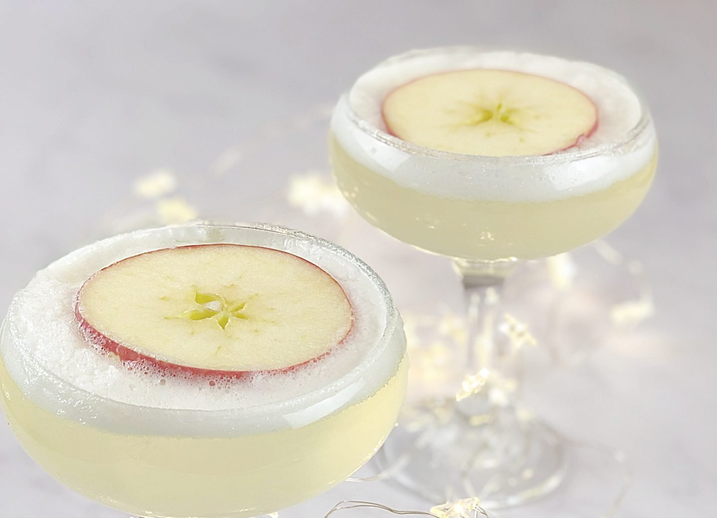 Gin and prosecco cocktail topped with elderflower foam