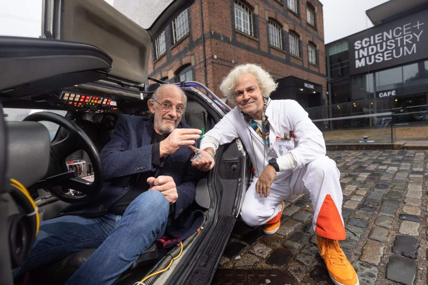 LtoR Christopher Lloyd & Roger Bart (Doc Brown) at the Manchester launch for Back to the Future the Musical, credit Phil Treagus