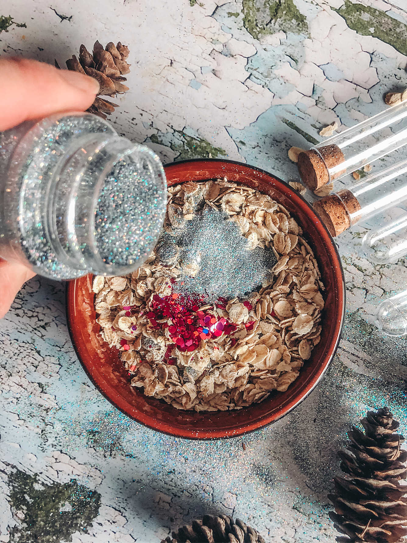 Add silver holographic glitter and red glitter to porridge oats