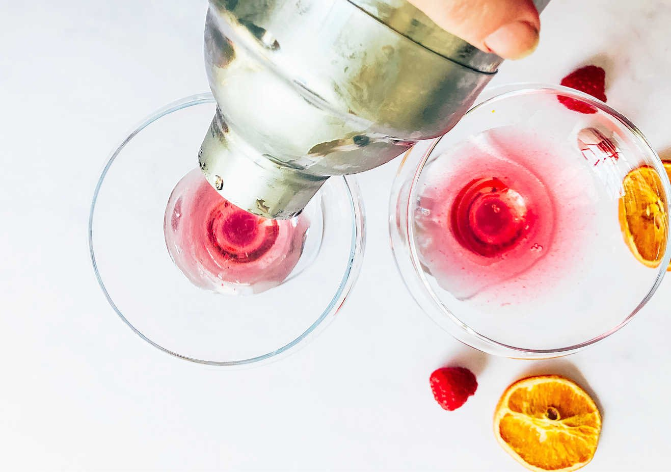 Add the cranberry gin to a cocktail mixer with ice and shake to cool