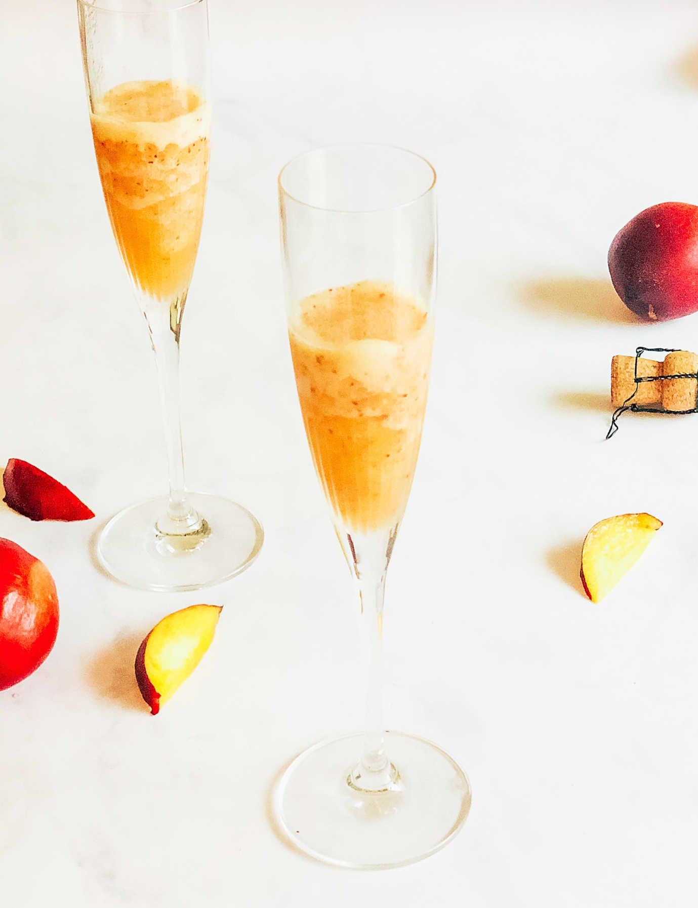 Add the peach mixture to the bottom of the Champagne glass
