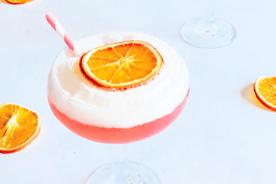 Cranberry Gin Fizz with a sweet foam top