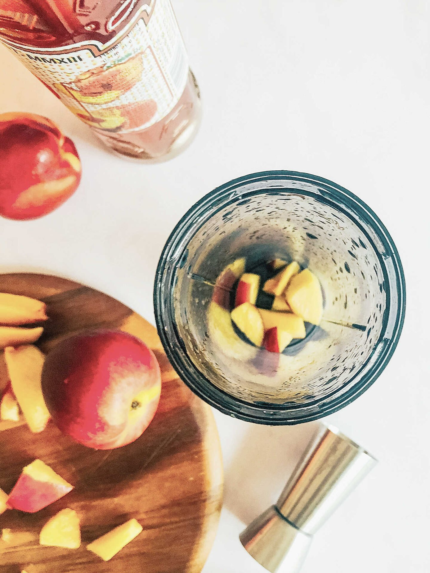 chop 1 peach into small chinks and place in a blender