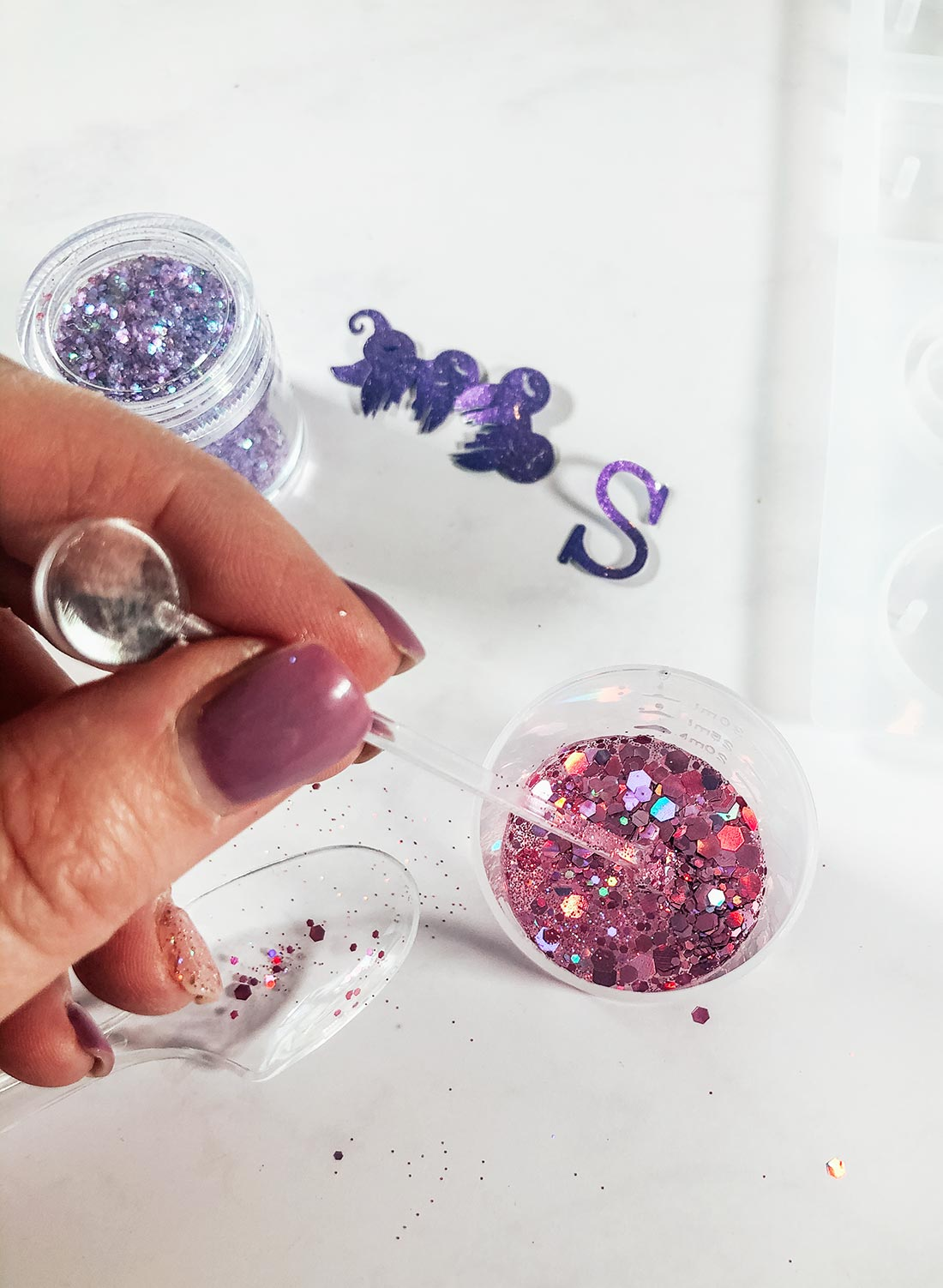 You can mix the glitter into your resin or sprinkle it in the encapsulate