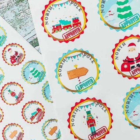 Free Printable Print and Cut North Pole Stamp Stickers to cut out by hand or on a cricut, perfect for using to wrap gifts or seal envelopes.