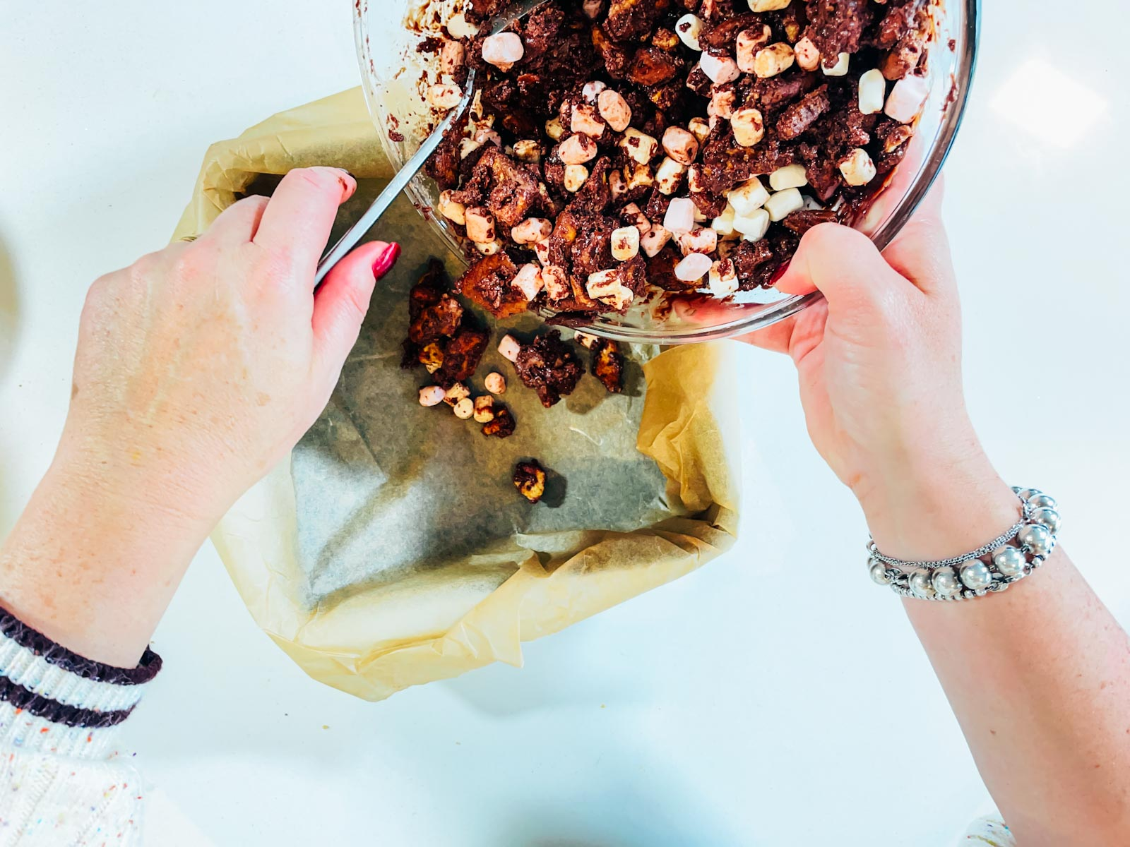 Add the rocky road mixture to a tin lined with grease proof paper